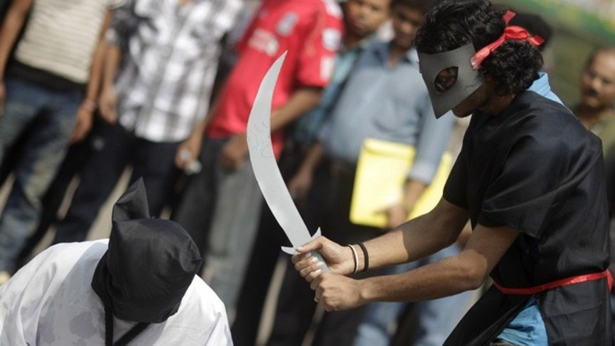 Members of Magic Movement stage a mock execution in protest against beheadings in Saudi Arabia (Reuters)