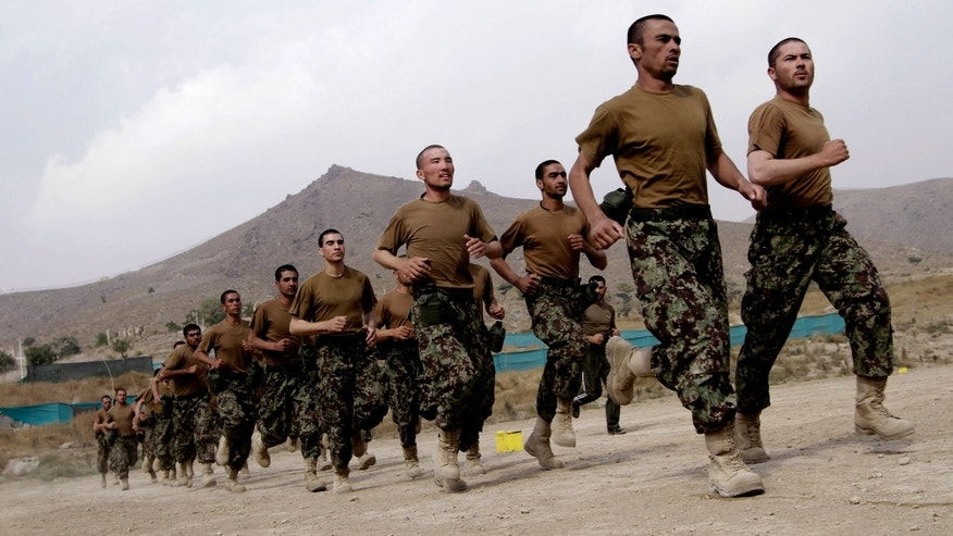 Afghan National Army officers jog during their inauguration ceremony at the Afghan Army Academy on the outskirts of Kabul, Afghanistan, Wednesday, Oct. 23, 2013. Army soldiers have easier access to education through this academy. (AP Photo/Rahmat Gul)