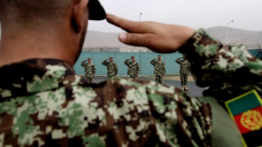 Afghan National Army officers salute during their inauguration ceremony at the Afghan Army Academy on the outskirts of Kabul, Afghanistan, Wednesday, Oct. 23, 2013. Army soldiers have easier access to education through this academy. (AP Photo/Rahmat Gul)