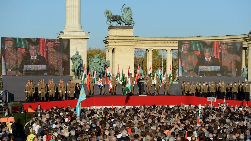 Hungarian Prime Minister Viktor Orban delivers his speech during a ceremony to mark the 57th anniversary of the Hungarian revolution and war of independence against communist rule and the Soviet Union in 1956 in Budapest, Hungary, Wednesday, Oct. 23, 2013.  (AP Photo/MTI,Tamas Kovacs)