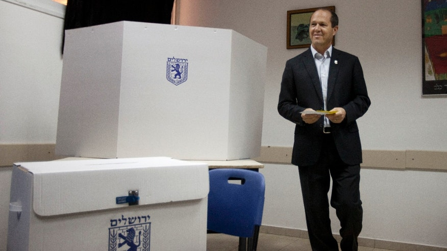 Jerusalem mayor Nir Barkat, votes in Jerusalem, Tuesday, Oct. 22, 2013. The mayors of Israel's two largest cities are fighting for their political survival in municipal elections with national implications. (AP Photo/Sebastian Scheiner)