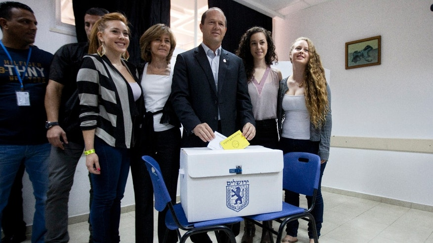 Jerusalem mayor Nir Barkat, center, poses with his family as he votes in Jerusalem, Tuesday, Oct. 22, 2013. The mayors of Israel's two largest cities are fighting for their political survival in municipal elections with national implications. (AP Photo/Sebastian Scheiner)