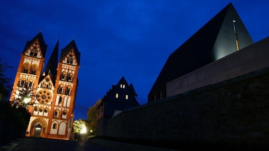 Oct. 14, 2013: Bishop Franz-Peter Tebartz-van Elst's residence and his private chapel, right, are pictured next to Limburg Cathedral, left, in Limburg.