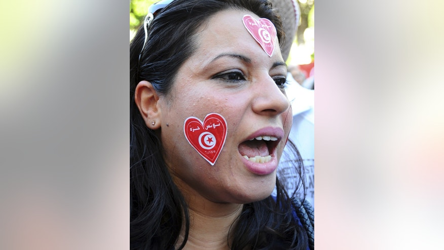 A woman shouts during a protest in Tunis, Wednesday, Oct. 23, 2013, calling for the resignation of the government.  Some thousands demonstrated in Tunisia on the day of the opening of the country's national dialogue calling for the Islamist-led government to keep its promise and resign to allow fresh elections. (AP Photo/Hassene Dridi)