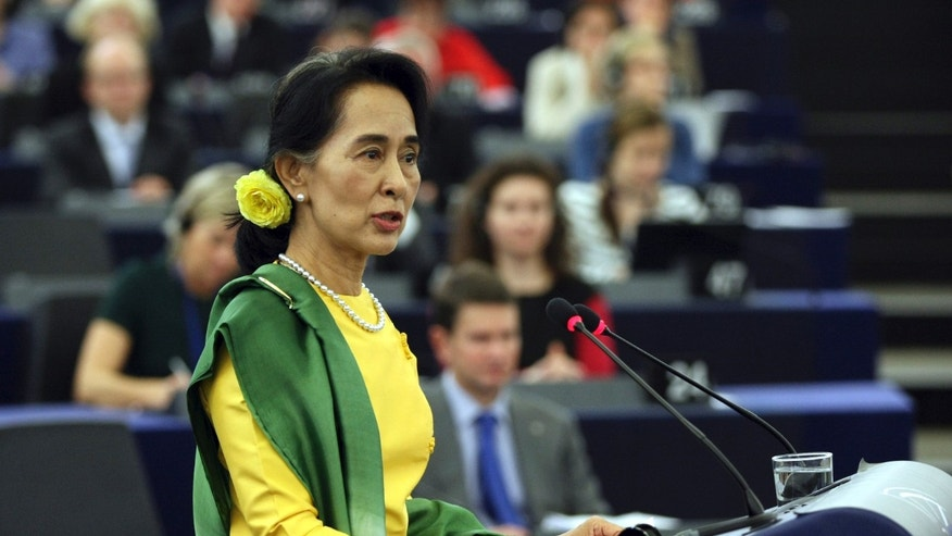Aung San Suu Kyi, Myanmar's Nobel Peace Prize laureate and long-time political prisoner, delivers a speech after receiving the European Union's 1990 Sakharov Prize for human rights at the European parliament in Strasbourg eastern France Tuesday Oct 22, 2013. Suu Kyi has persevered for decades in promoting democracy. She and her National League for Democracy party were frozen out of politics by the military regime that governed until 2011, and last year she and several dozen party members won parliamentary seats. (AP Photo/Christian Lutz)