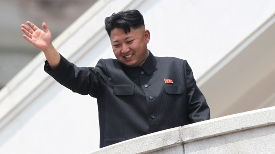 July 27, 2013: North Korean leader Kim Jong Un waves to war veterans during a mass military parade celebrating the 60th anniversary of the Korean War armistice in Pyongyang, North Korea. A Malaysian university faced public criticism Thursday for awarding an honorary doctorate in economics to North Korean leader Kim Jong Un, whose country is among the poorest in the world.