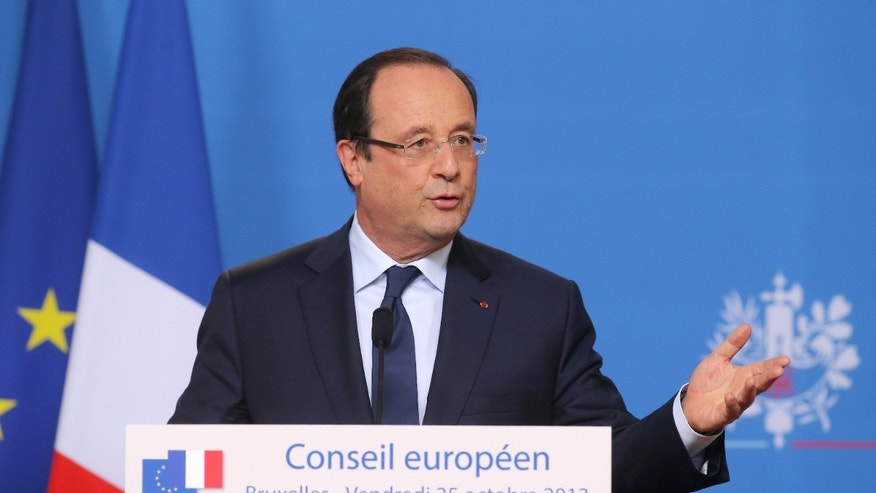 French President Francois Hollande addresses the media at the European Council building in Brussels, Friday, Oct. 25, 2013. Migration, as well as an upcoming Eastern Partnership summit, will top the agenda in Friday's meeting of EU leaders. (AP Photo/Michel Euler)