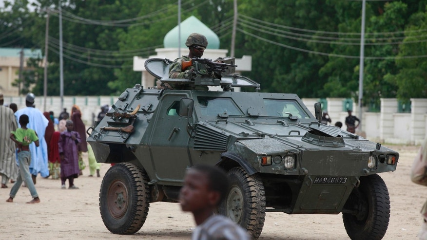 Aug. 8, 2013 - FILE photo of Nigerian soldiers on an armored personnel carrier during Eid al-Fitr celebrations in Maiduguri, Nigeria. Hundreds of people are dying in military detention as Nigeria's security forces crack down on an Islamic uprising in the northeast, Amnesty International said.