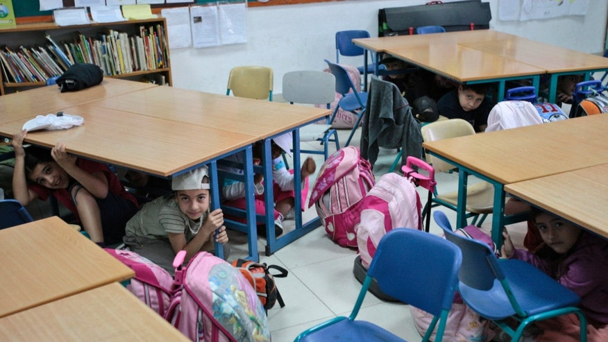 "FILE - In this Thursday, Feb. 18, 2010 file photo, Israeli school children take cover under their desks as they participate in a drill simulating an earthquake scenario in a school in Herzeliya, near Tel Aviv. As if Israel doesn't have enough to worry about, a problem millions of years in the making is now literally sending shockwaves throughout the country. Five mid-size earthquakes measuring between magnitude 3 and 4 have hit the Sea of Galilee area this past week, raising fears that the ""big one"" is on its way and could carry with it devastation that would dwarf what the country has faced from wars, violent Palestinian uprisings and even a potential nuclear attack from Iran. (AP Photo/Ariel Schalit, File)"