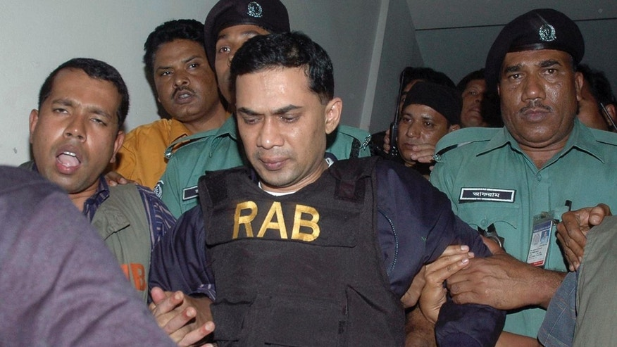 FILE - In this March 8, 2007 file photo, Tarique Rahman, center, who was charged with receiving bribes, is escorted by Bangladeshi security personnel to a court in Dhaka, Bangladesh. Political observers in Bangladesh said that given a few years Rahman, the 45-year-old son of opposition leader Khaleda Zia, and Sajeeb Wazed Joy, 42, the son of Prime Minister Sheikh Hasina, could become prime minister of Bangladesh, which has been ruled by their two families since the country's 1971 independence from Pakistan. Joy and Rahman have emerged as the country's most powerful political heirs. (AP Photo/Indrajit Kumer Ghosh, File)