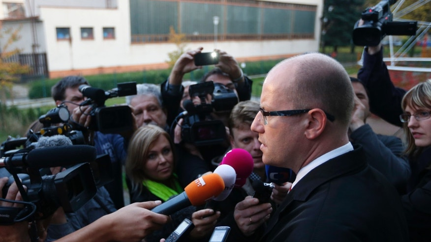 Chairman of Social Democratic party, Bohuslav Sobotka, answers questions to media after casting his vote during early elections  in Slavkov u Brna, Czech Republic, Friday, Oct. 25, 2013. Czech Republic holds the elections Oct. 25-26. (AP Photo/Petr David Josek)