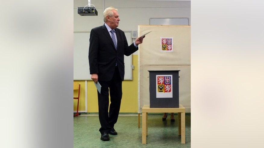 Czech President Milos Zeman vote during early parliamentary elections in Prague, Friday, Oct. 25, 2013. Czech Republic holds the elections Oct. 25-26. (AP Photo,CTK/Michal Kamaryt) SLOVAKIA OUT