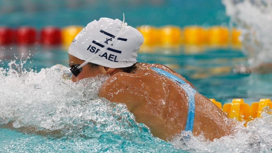 October 18, 2013 - Israel's Amit Ivry competes in the Women's 100meter Individual Medley final during the FINA Swimming World Cup in Dubai.