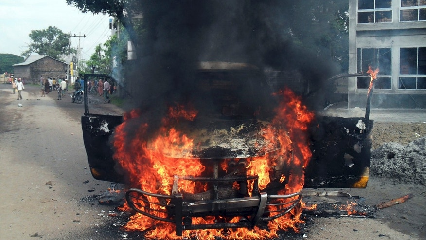 A vehicle burns after it was set on fire allegedly by opposition activists during a general strike in Josohor, outskirts of Dhaka, Bangladesh, Sunday, Oct. 27, 2013.  Police and supporters of Bangladesh's ruling party clashed Sunday with opposition supporters, leaving at least five people dead and scores injured in different parts of the country as opposition parties tried to enforce a three-day nationwide general strike. (AP Photo)