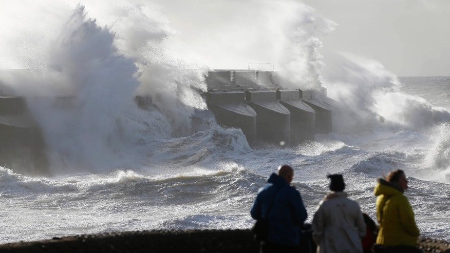 Oct. 28, 2013 - People watch waves batter the sea wall of a marina in Brighton, south England. A major storm with hurricane force winds is lashing much of Britain, causing flooding and travel delays including the cancellation of roughly 130 flights at London's Heathrow Airport.