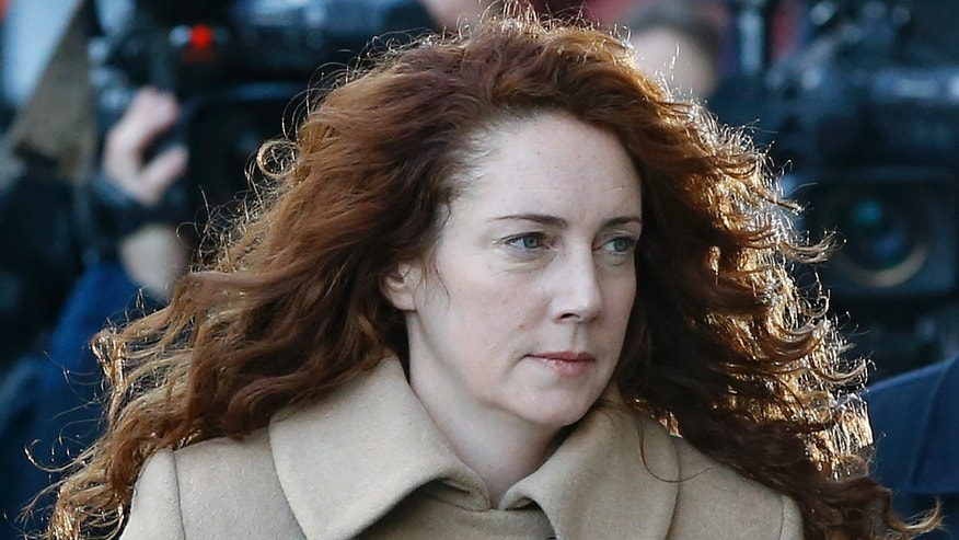 Oct. 28, 2013 - Rebekah Brooks arrives at court in London. Former 'News of the World' national newspaper editors Brooks and Andy Coulson went on trial Monday, along with several others, on charges of hacking phones and bribing officials while at the now-closed tabloid paper.