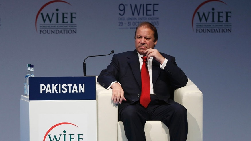 Pakistan's Prime Minister Nawaz Sharif listens to a speech during the 9th World Islamic Economic Forum at the ExCeL exhibition and convention center in London, Tuesday, Oct. 29, 2013. (AP Photo/Sang Tan)