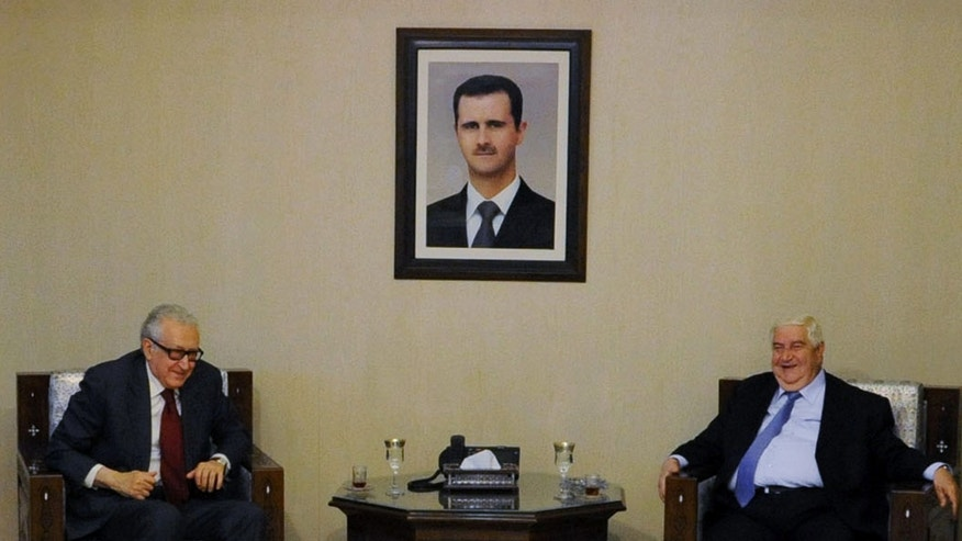 In this photo released by the Syrian official news agency SANA, U.N.-Arab League envoy for Syria, Lakhdar Brahimi, left, smiles as he meets with Syrian Foreign Minister Walid al-Moallem in Damascus, Syria, Tuesday Oct. 29, 2013. Brahimi met a senior opposition figure in Damascus as part of a diplomatic push to convince all sides in the country's crisis to attend peace talks in Geneva next month. (AP Photo/SANA)