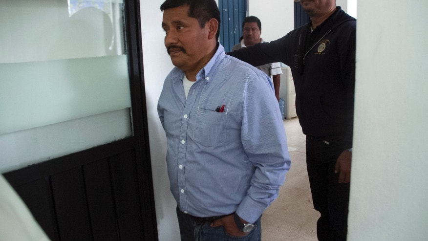 In this Sept. 24, 2013 photo, Alberto Patishtan, a teacher detained in June 2000 accused of participating in the ambush and killing of seven police officers, is escorted by a prison guard as he enters the visitors area inside the CERESO 5 prison near the city of San Cristobal de las Casas, Mexico. Mexican President Enrique Pena Nieto tweeted late Tuesday, Oct. 29, 2013, on his official Twitter account, that Patishtan who rights groups insist has been unjustly imprisoned for 13 years will be the first person he pardons under a change in the penal code that takes effect Thursday. (AP Photo/Moyses Zuniga)