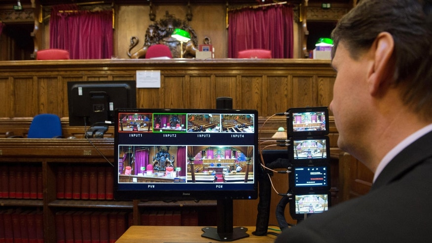 Monitors viewing TV camera positions are prepared inside Court Four at the Royal Courts of Justice in London in this photo taken Monday Oct. 21, 2013, during preparations for the first ever live TV transmission from inside a court in England. Television cameras will be allowed inside the Court of Appeal, one of Britain's highest courts for the first time from Thursday Oct. 31, 2013, partially lifting a ban on filming in court that has been in place for almost a century. (AP Photo / Stefan Rousseau, PA) UNITED KINGDOM OUT - NO SALES - NO ARCHIVES