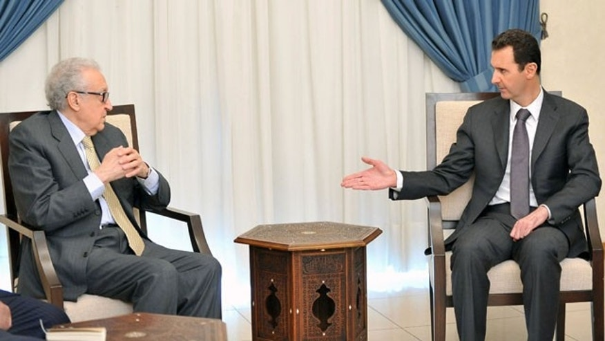 October 30, 2013: In this photo released by the Syrian official news agency SANA, Syrian President Bashar Assad, right, speaks with U.N.-Arab League envoy for Syria, Lakhdar Brahimi, in Damascus, Syria. (AP Photo)