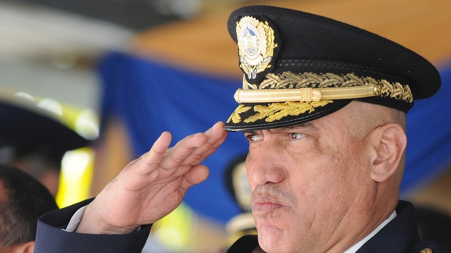 "In this Dec. 21, 2012 photo, Honduras Police Chief, Gen. Juan Carlos Bonilla, salutes during an event in Tegucigalpa, Honduras. The five-star general was accused a decade ago of running deaths squads and today oversees a department suspected of beating, killing and ""disappearing"" its detainees. He also is the top cop in the country that serves as a way station for most South American cocaine bound for the United States and beyond. Bonilla is also the U.S. government's go-to man in Honduras for the war on drug trafficking. (AP Photo/Fernando Antonio)"
