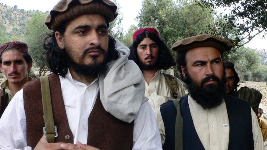 Oct. 4, 2009 - FILE photo of  Pakistani Taliban chief Hakimullah Mehsud, left, with comrade Waliur Rehman during a meeting with media in Sararogha, a Pakistani tribal area of South Waziristan.