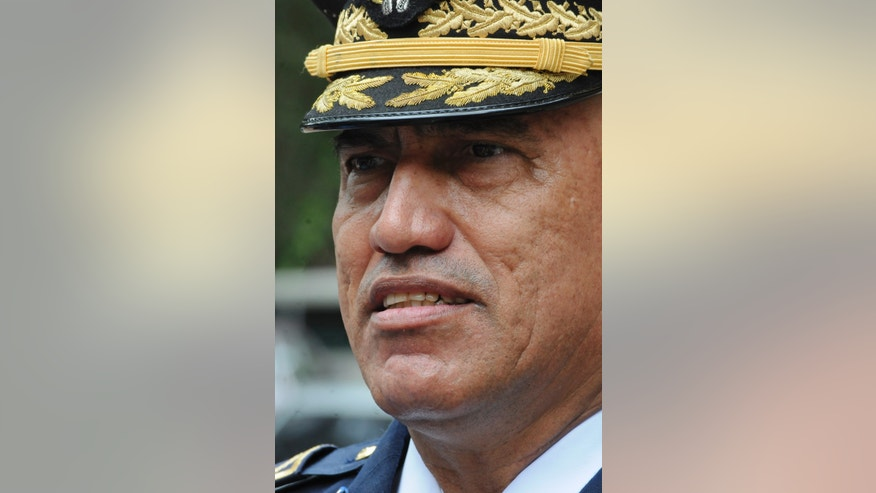 """In this July 24, 2013 photo, Honduras Police Chief, Gen. Juan Carlos Bonilla, speaks to the press in Tegucigalpa, Honduras. The five-star general was accused a decade ago of running deaths squads and today oversees a department suspected of beating, killing and """"disappearing"""" its detainees. He also is the top cop in the country that serves as a way station for most South American cocaine bound for the United States and beyond. Bonilla is also the U.S. government's go-to man in Honduras for the war on drug trafficking. (AP Photo/Fernando Antonio)"""