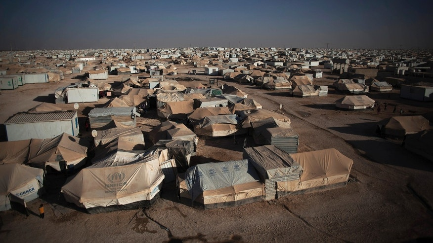 This Wednesday, Oct. 23, 2013, photo shows a general view of Zaatari refugee camp near the Syrian border in Jordan. With Syria's civil war in its third year, more than 2 million Syrians have fled their country. About 100,000 live in this camp. (AP Photo/Manu Brabo)