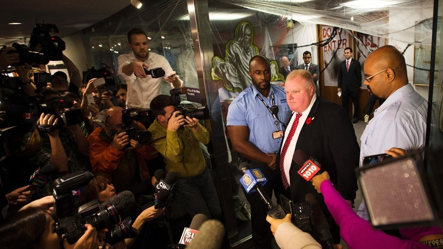 Toronto Mayor Rob Ford addresses media outside his office in Toronto on Thursday, Oct. 31, 2013. Ford says he has no reason to step down despite police confirmation that they have seized a video that appears to show him smoking a crack pipe.(AP Photo/The Canadian Press, Nathan Denette)