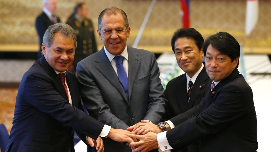 "Russian Foreign Minister Sergey Lavrov, second from left, and Defense Minister Sergei Shoigu, left, pose with Japanese Foreign Minister Fumio Kishida, second from right, and Defense Minister Itsunori Onodera for photographers at the start of their foreign and defense ministers meeting called ""two-plus-two"" at Iikura guest house in Tokyo Saturday, Nov. 2, 2013. (AP Photo/Issei Kato, Pool)"
