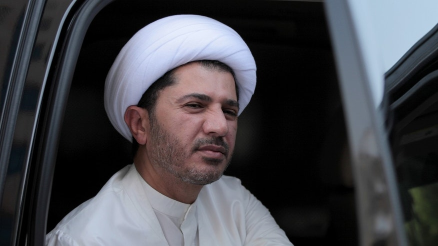 "Sheik Ali Salman, leader of the largest Shiite opposition group, the Al Wefaq Society, arrives in response to a summons for questioning at the public prosecutor's office on Sunday, Nov. 3, 2013. The Bahraini government issued a statement accusing Salman of ""denigrating and disparaging the Interior Ministry"" through his society's museum-style exhibition of scenes from the 2 1/2-year-old pro-democracy uprising that police shut down last week. (AP Photo/Hasan Jamali)"
