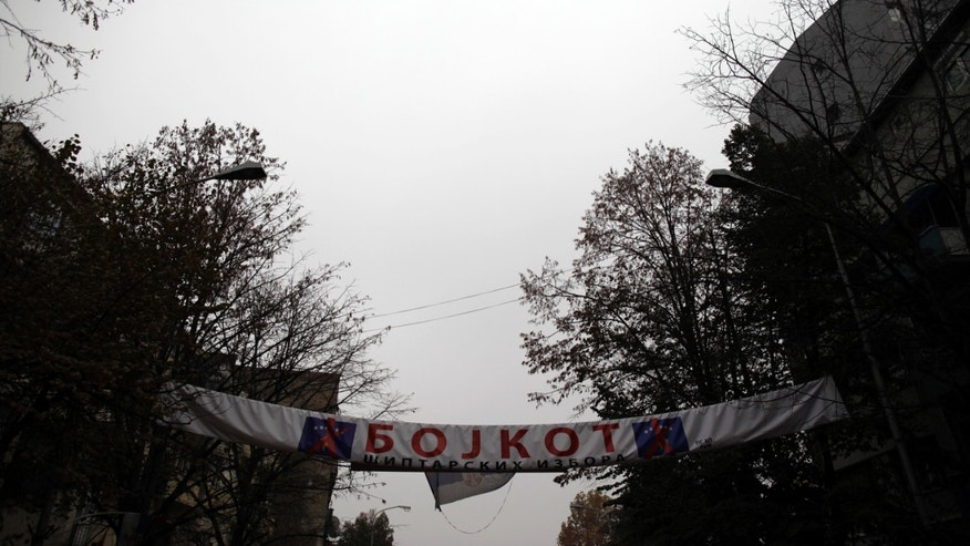 A banner that reads: Boycott for Albanian elections'' flies over a street in the northern, Serb-dominated part of Mitrovica, Kosovo Saturday, Nov 2, 2013. Kosovo local elections are scheduled for November 3. As part of attempts to normalize its relations with Kosovo, Serbia has agreed to convince Kosovo Serbs to end their boycott of ethnic Albanian dominated institutions in protest over Kosovo's 2008 secession from Serbia. Serbia claims the territory as its own. (AP Photo/Darko Vojinovic)