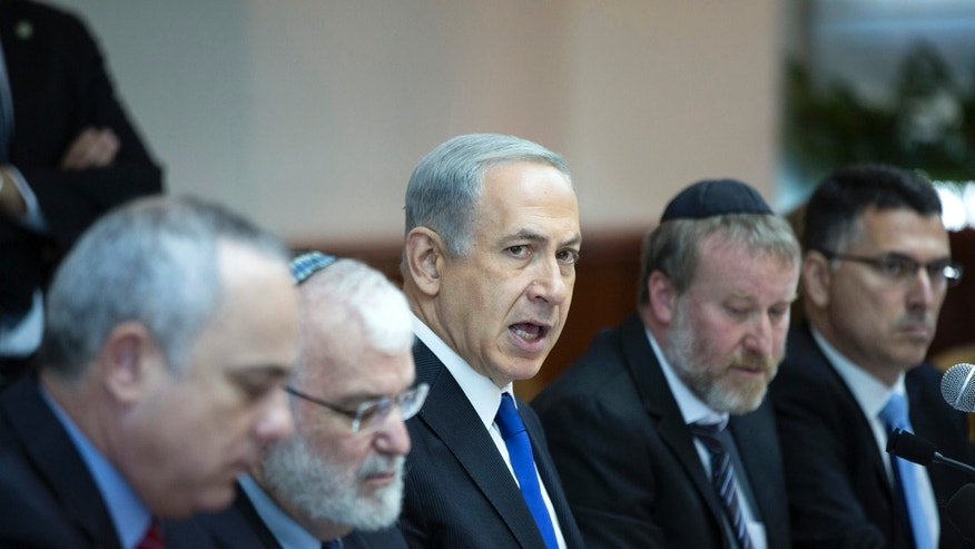 Israel's Prime Minister Benjamin Netanyahu, center, attends the weekly cabinet meeting in Jerusalem, Sunday, Nov. 3, 2013. (AP Photo/Baz Ratner, Pool)