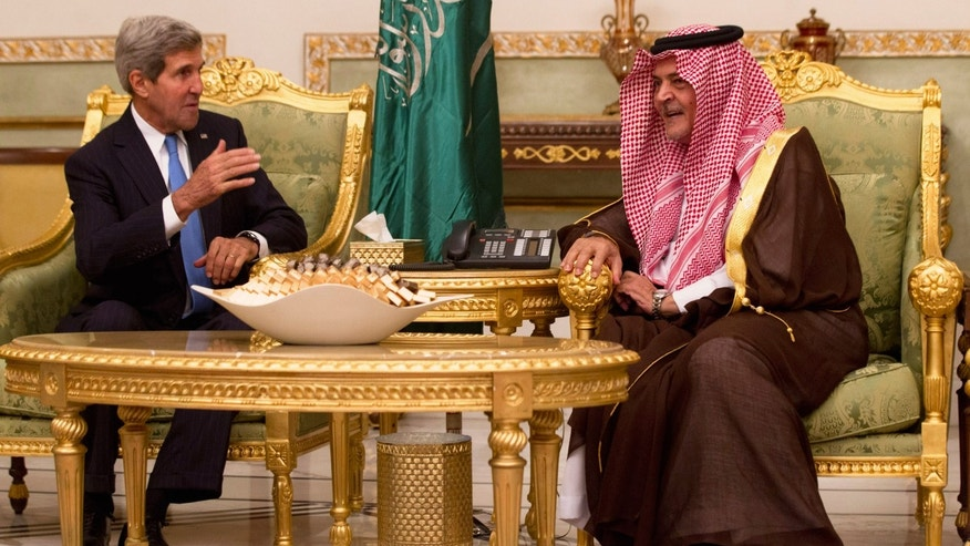 Nov. 3, 2013 U.S. Secretary of State John Kerry, left,  talks with Saudi Foreign Minister Prince Saud Al-Faisal bin Abdulaziz al-Saud, after Kerry arrived in Riyadh, Saudi Arabia.