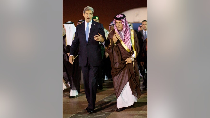 U.S. Secretary of State John Kerry, left,  is escorted by Saudi Foreign Minister Prince Saud Al-Faisal bin Abdulaziz al-Saud, as Kerry arrives in Riyadh, Saudi Arabia, Sunday, Nov. 3, 2013.  (AP Photo / Jason Reed, Pool)