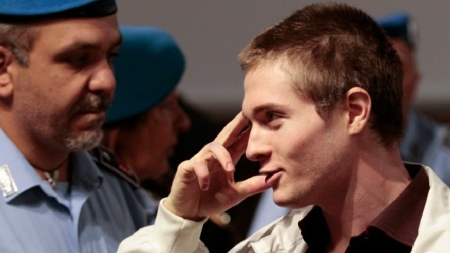 October 3, 2011: Raffaele Sollecito, the Italian student who was tried in the murder of Meredith Kercher in Italy in November 2007, gestures as he arrives for his appeal trial session in Perugia.