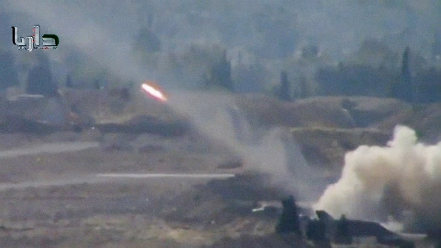 In this image taken from video obtained from the Shaam News Network, which has been authenticated based on its contents and other AP reporting, a rocket soars through the air in Daraya on the outskirts of Damascus, Syria, Tuesday, Nov. 5, 2013. (AP Photo/Shaam News Network via AP Video)