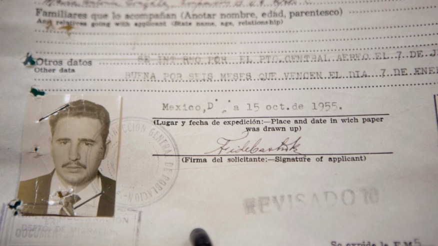 A 1955 Mexican immigration document of Cuba's Fidel Castro is displayed as part of the National Migration Institute exhibit marking the 20th anniversary of the organization's creation, in Mexico City, Tuesday, Nov. 5, 2013. The exhibit of 16 personalities that include Castro, Russian Marxist revolutionary Leon Trotsky and Nicaraguan guerrilla leader Augusto Cesar Sandino, is a sample of the nearly 500,000 records that make up the institute's archive. (AP Photo/Eduardo Verdugo)