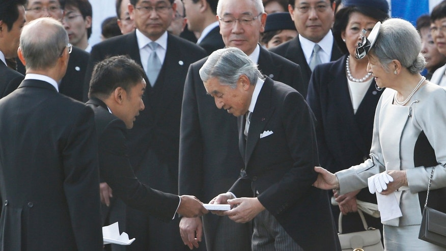 FILE - In this Thursday, Oct. 31, 2013 file photo, actor-turned-lawmaker Taro Yamamoto, second left, hands over a letter to Japan's Emperor Akihito, second right, as Empress Michiko, right, and chief steward Yutaka Kawashima, top center, look on during the autumn garden party at the Imperial Palace in Tokyo. The novice lawmaker has caused an uproar in Japan by doing something taboo: handing a letter to the emperor - a gesture considered both impolite and inappropriate. Yamamoto, 38, an anti-nuclear activist, said he only wanted to make an appeal to the emperor about the crisis in Fukushima and its possible health impact on residents and workers cleaning up the power plant, which was devastated by the 2011 earthquake and tsunami. (AP Photo/Koji Sasahara, File)