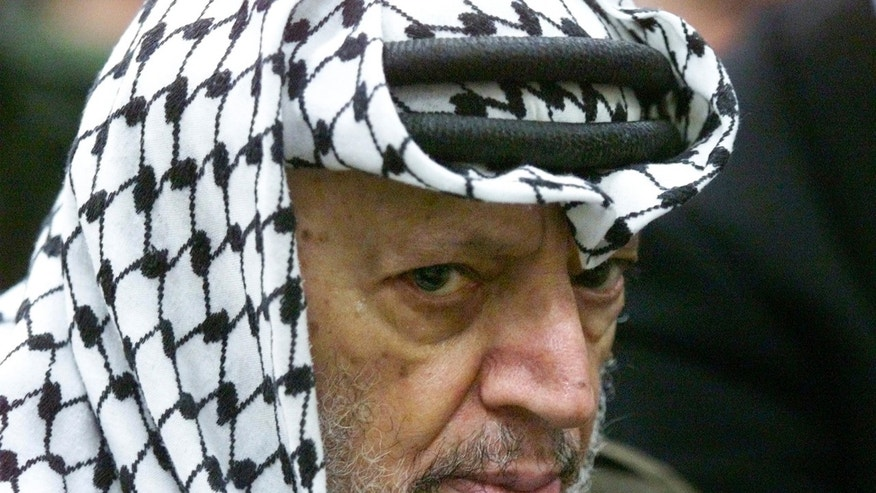 FILE - In this May 31, 2002 file photo, Palestinian leader Yasser Arafat pauses during the weekly Muslim Friday prayers in his headquarters in the West Bank city of Ramallah. Al-Jazeera is reporting that a team of Swiss scientists has found moderate evidence that longtime Palestinian leader Arafat died of poisoning. The Arab satellite channel published a copy of what it said was the scientists' report on its website on Wednesday, Nov. 6, 2013.(AP Photo/Lefteris Pitarakis, File)