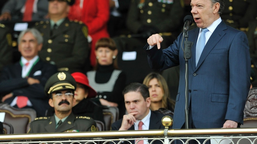 Colombia's President Juan Manuel Santos speaks during a graduation ceremony for police cadets in Bogota, Colombia, Wednesday, Nov. 6, 2013. Representatives of the Colombian government and rebel negotiators of the Revolutionary Armed Forces of Colombia, FARC, announced in Havana on Wednesday a partial agreement covering the guerrillas' participation in national politics, if talks they are holding in Cuba reach a final deal. (AP Photo/Carlos Julio Martinez)
