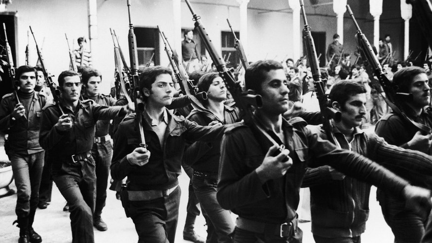 FILE - In this Jan. 3, 1977, file photo, recruits in the Phalange Party militia go through training procedures at the Christina Militia Security Garrison, in Beirut, Lebanon. The Lebanese civil war itself played out in several stages between 1975 and 1990. Over that time, Christians fought Palestinians, Lebanese Sunni and Shiite Muslims and Druse. At one point, Christian groups turned their guns on each other, in a nasty episode of fratricidal bloodshed later repeated by Shiite militias. (AP Photo, File)
