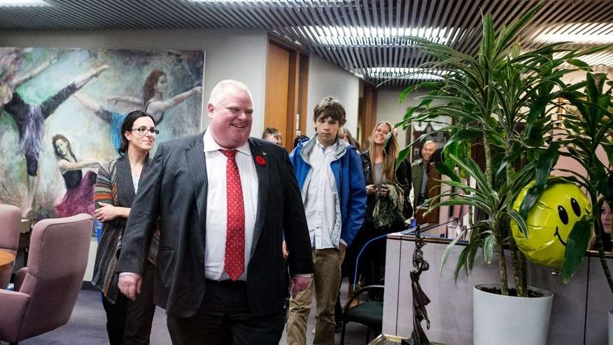 "Toronto Mayor Rob Ford leads a tour of city hall staff member's children around the offices at city hall on take you kids to work day, Wednesday, Nov. 6, 2013 in Toronty. City councilors called on the deputy mayor to ""orchestrate a dignified"" departure for Ford, who was greeted by angry protesters on his first day of work after acknowledging he smoked crack. Ford took a back stairway to his office to avoid a crush of media and protestors. (AP Photo/The Canadian Press, Chris Young)"