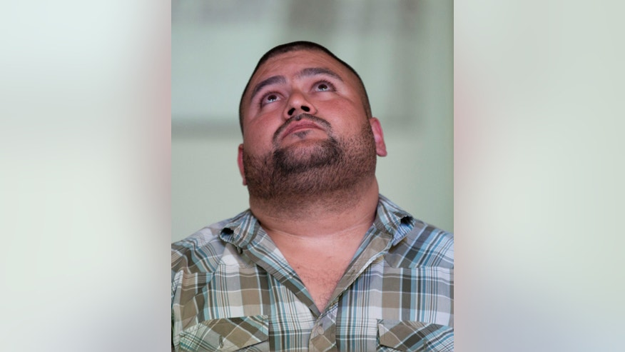 Israel Arzate looks upward during a news conference in Mexico City, Thursday, Nov. 7, 2013. Human rights groups are welcoming a Mexican Supreme Court decision to free Azarte who claimed soldiers tortured him into confessing to a role in a drug-related massacre. The court ruled the 28-year-old's confession wasn't valid because he talked to soldiers rather than prosecutors, as the law requires. (AP Photo/Eduardo Verdugo)