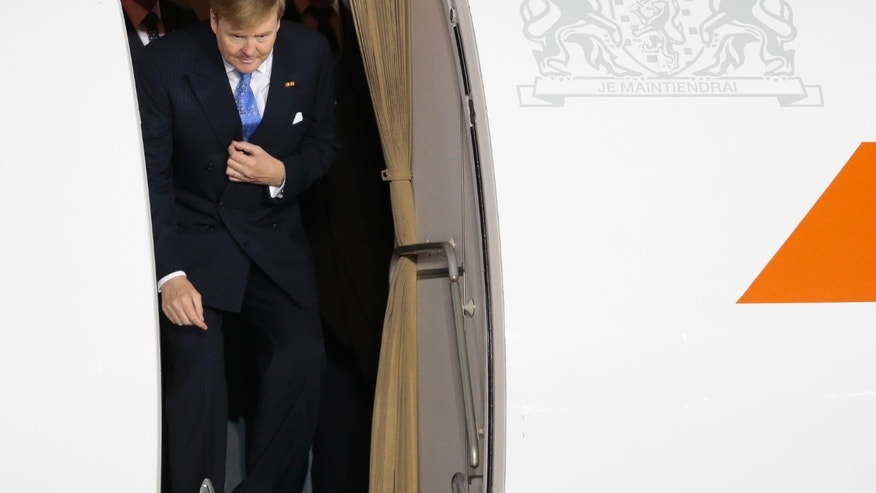 Dutch King Willem-Alexander leaves a plane shortly upon his arrival to Vnukovo II airport outside Moscow, Russia, on Friday, Nov. 8, 2013. (AP Photo/Ivan Sekretarev)