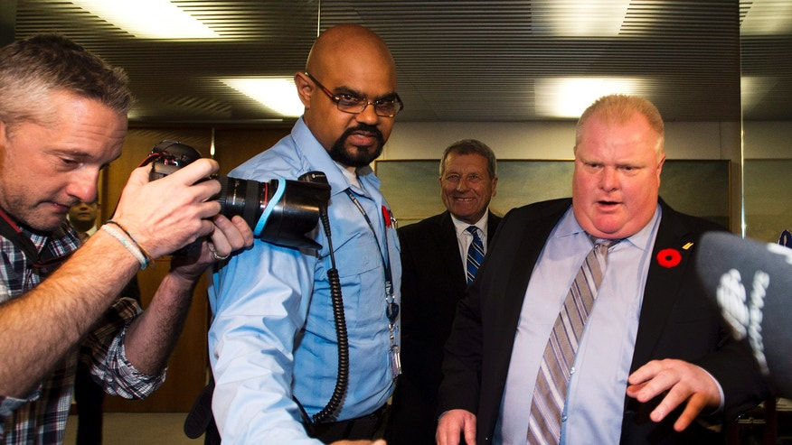 """City of Toronto Mayor Rob Ford, right, walks to address the media outside his office in Toronto on Thursday, Nov. 7, 2013. A new video surfaced showing Ford in a rage, using threatening words including """"kill"""" and """"murder."""" Ford said he was """"extremely, extremely inebriated"""" in the video, which appeared Thursday on the Toronto Star's website. The context of the video is unknown and it's unclear who the target of Ford's wrath is. (AP Photo/The Canadian Press,Nathan Denett)"""