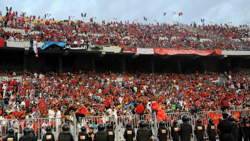 Nov. 4, 2012: In this file photo, Egyptian riot police stand guard at the Borg El-Arab Stadium stadium near Alexandria, Egypt, before Egypt's Al-Ahly club takes on Tunisia's Esperance for a match in the first leg of the African Champions League final near Alexandria, Egypt.