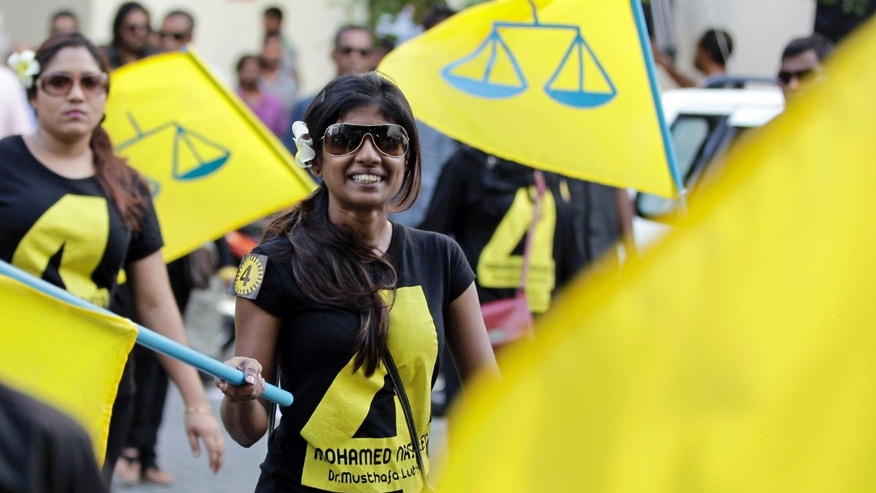 Supporters of former President Mohamed Nasheed participate in a final election campaign rally in Male, Maldives, Friday, Nov. 8, 2013. Voters in Maldives will choose a new president for their vulnerable new democracy on Saturday. (AP Photo/Sinan Hussain)