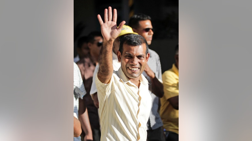 Former President Mohamed Nasheed waves to supporters during the final election campaign rally in Male, Maldives, Friday, Nov. 8, 2013. Voters in Maldives will choose a new president for their vulnerable new democracy on Saturday. (AP Photo/Sinan Hussain)